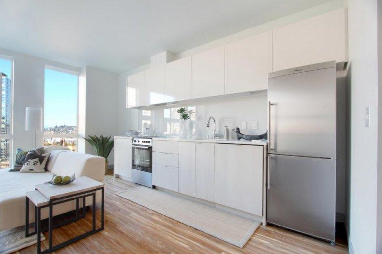 Кухня в квартире-студии — фото планировки интерьера и варианты обустройства кухонной и столовой зоны